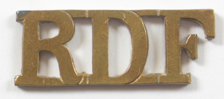 RDF Royal Dublin Fusiliers pre 1922 brass shoulder title