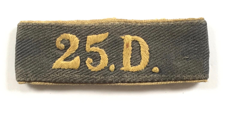 25.D. WW2 slip on cloth shoulder title.