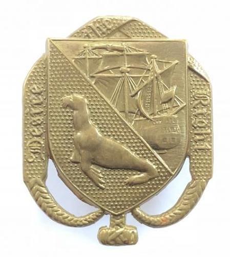 Falkland Islands Volunteer Corps die-stamped brass cap badge.