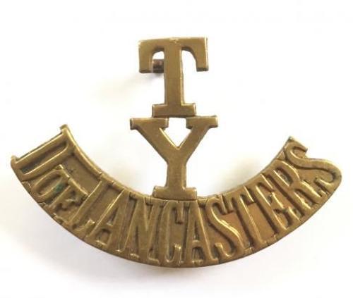 T / Y / D OF LANCASTERS brass shoulder title.