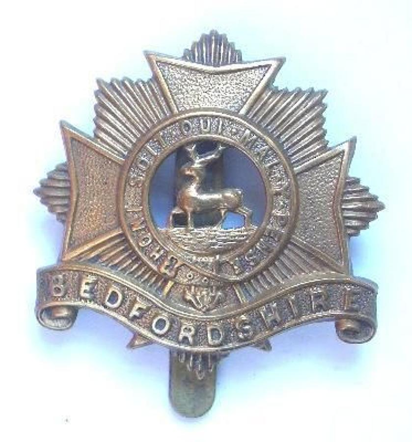 Bedfordshire Regiment 1916 all brass economy cap badge.