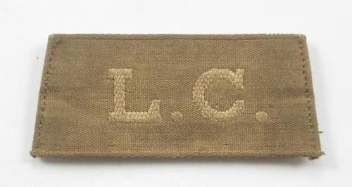 WW1 Labour Corps Slip on Cloth Shoulder Title.