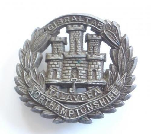 WW2 Northamptonshire Regiment Economy Issue Plastic Cap Badge.