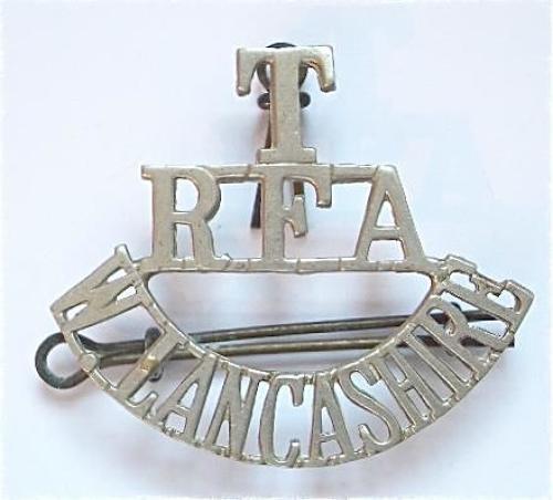 T / RFA / W.LANCASHIRE post 1908 Royal Field Artillery white metal shoulder title.