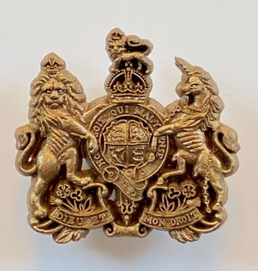 General List scare light bronze WW2  plastic economy cap badge