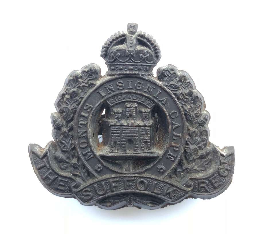 Suffolk Regiment WW2 rare dark brown plastic economy cap badge