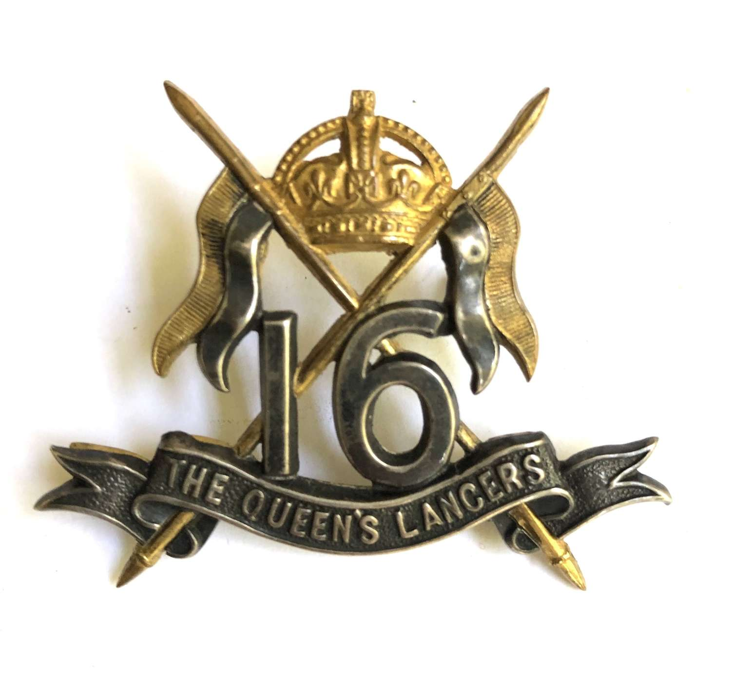 16th The Queen's Lancers Officer's silver and gilt cap badge