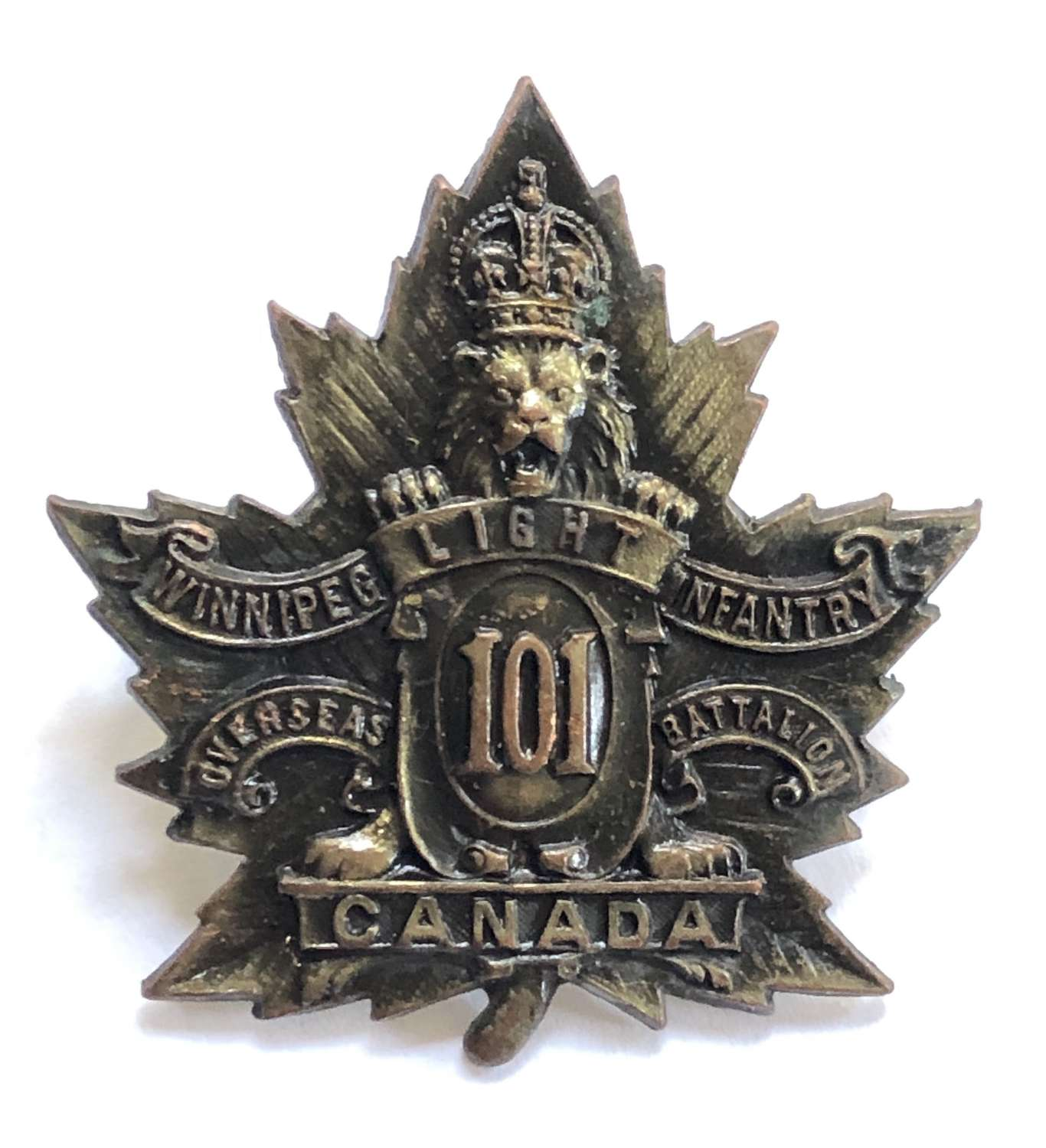 Canadian WW1 101st CEF bronze cap badge by R.J. Inglis