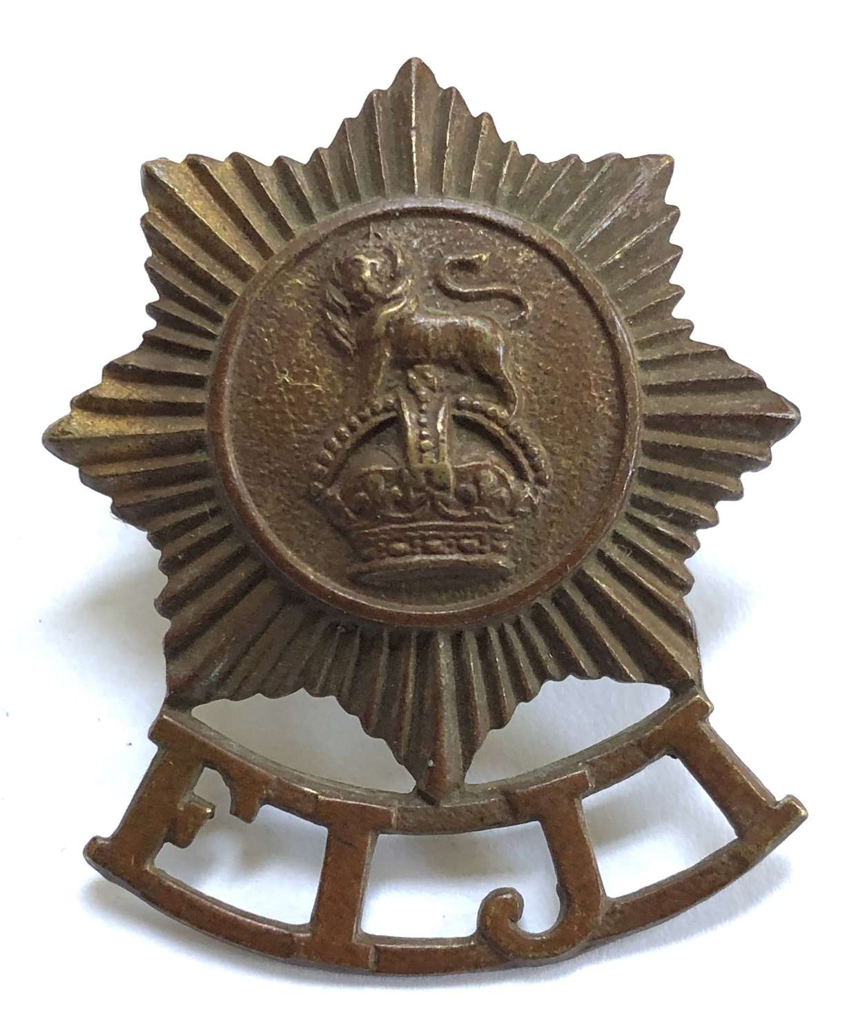 Fiji Defence Force brass cap badge with JR Gaunt, London
