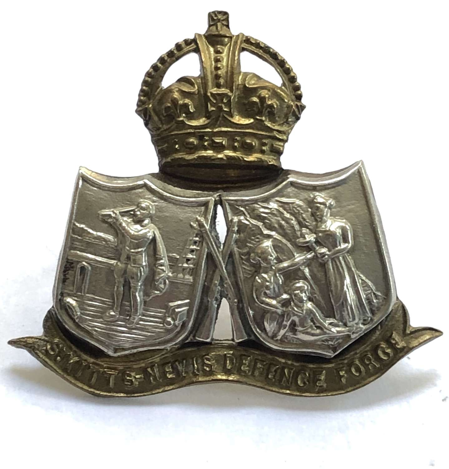 St. Kitts Nevis Defence Force scarce OR's bi-metal cap badge