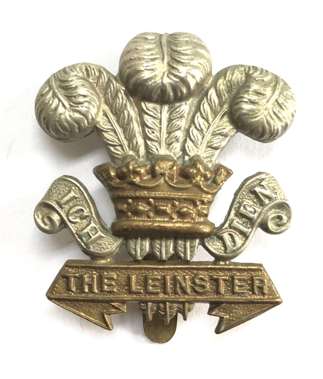 Irish. Leinster Regiment WW1 curled scrolls OR's bi-metal cap badge