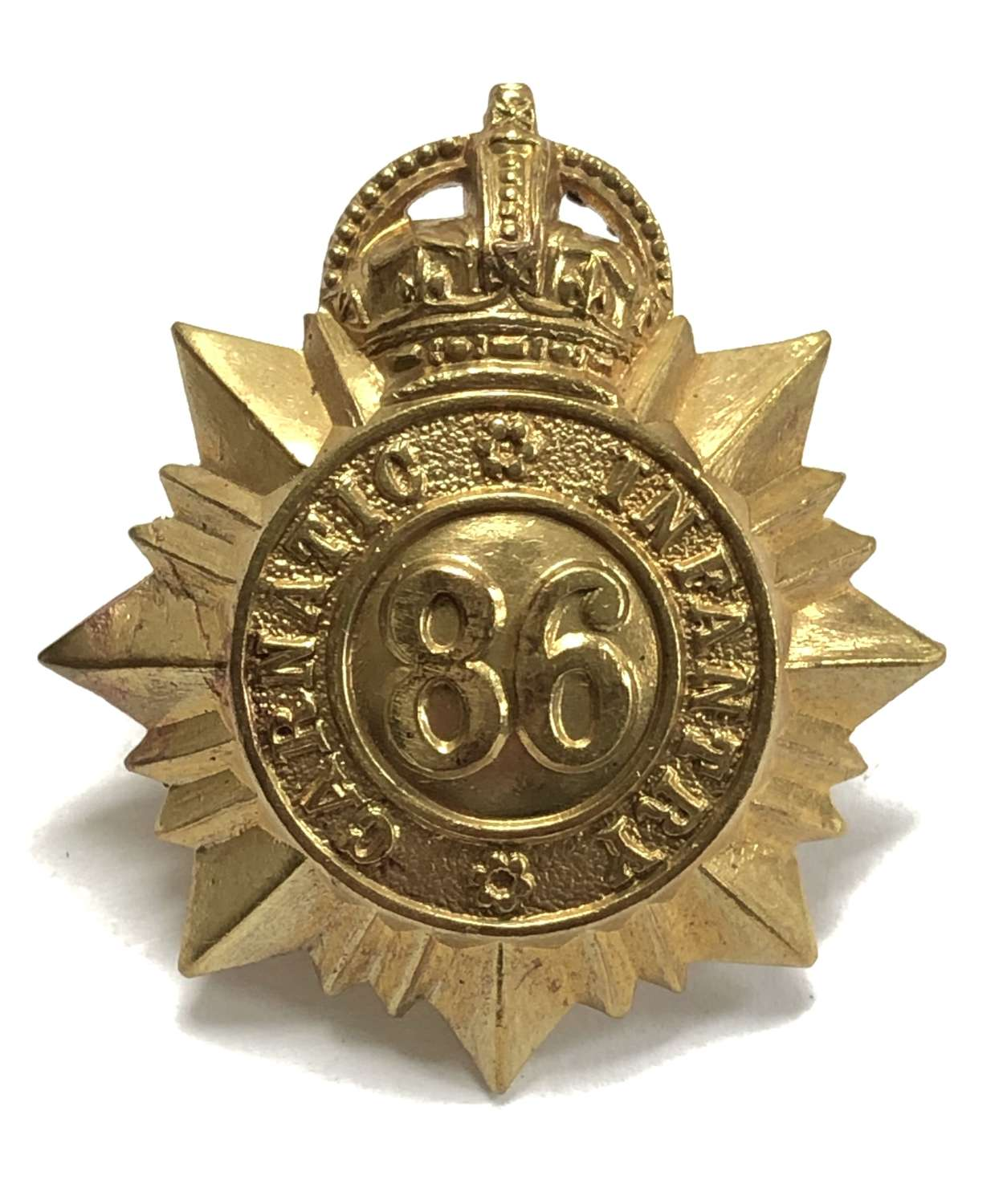 Indian Army. 86th Carnatic Infantry cap badge circa 1903-22