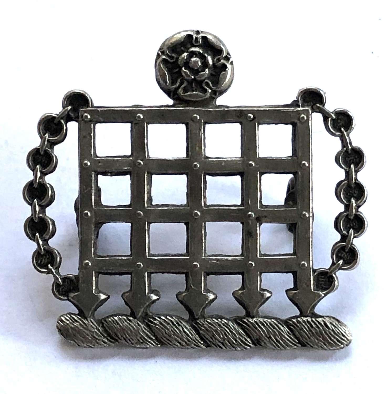 Emmanuel School scarce white metal badge