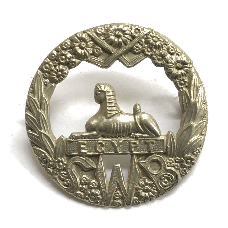 South Wales Borderers white metal cap badge c1896-1908