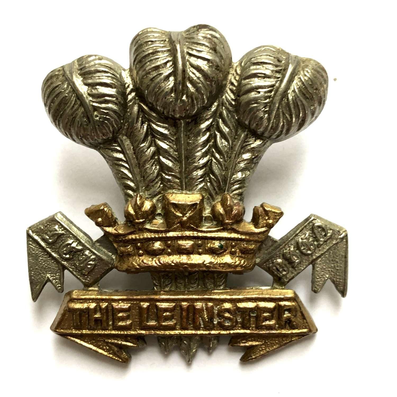 Irish. Leinster Regiment cap badge on loops