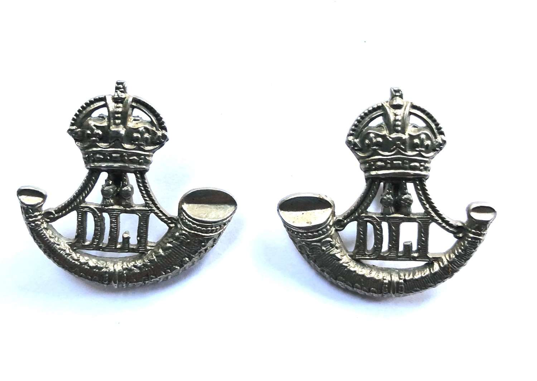 Durham Light Infantry facing pair of DLI collar badges